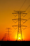 Electricity Pylons against Sunset Stock Image