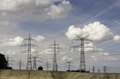 Electricity pylons in a agricultural landscape Royalty Free Stock Photography