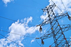 Electricity pylons. With a blue sky Royalty Free Stock Photos