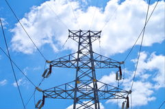 Electricity pylons. With a blue sky Stock Photos