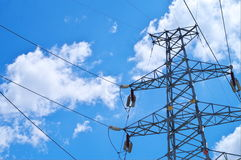 Electricity pylons. With a blue sky Royalty Free Stock Image