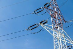 Electricity pylons with blue sky background Royalty Free Stock Photo