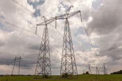 Electricity pylons and cable lines Royalty Free Stock Image