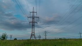 Electricity pylons and clouds. Electricity pylons and beautiful clouds. Timelapse. 4K stock footage