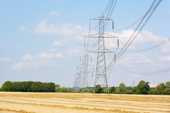 Electricity pylons in countryside Stock Images