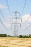 Electricity pylons in countryside Stock Photography