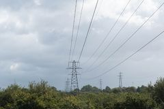 Electricity pylons cross the countryside Royalty Free Stock Images