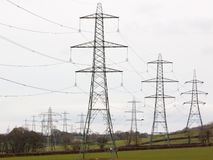 Electricity pylons dominating the landscape Stock Images