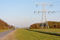 Electricity pylons in Dutch farmland Stock Image