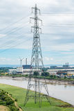 Electricity pylons. Electrical pylons running along a river Royalty Free Stock Photography