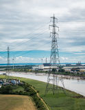 Electricity pylons. Electrical pylons running along a river Royalty Free Stock Photos