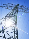Electricity pylons. In front of blue sky royalty free stock photo
