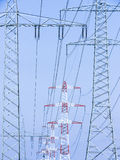 Electricity pylons. In front of blue sky royalty free stock images