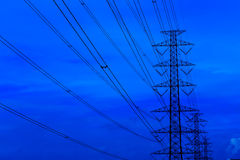Electricity pylons and high voltage lines . High voltage power pole at large . With blue sky Royalty Free Stock Photo