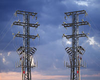 Electricity pylons with high-voltage wires Stock Photography