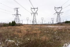 High Voltage Electricity Pylons on a Cloudy Winter Day Royalty Free Stock Images