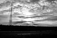 Electricity pylons in landscape  Royalty Free Stock Image