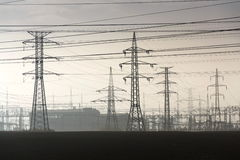 Electricity pylons leading from distribution power station Royalty Free Stock Photos