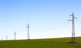 Electricity pylons line  Stock Images