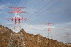 Electricity pylons in mountain landscape Royalty Free Stock Photo