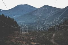 Electricity pylons and mountains Royalty Free Stock Images