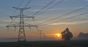 Electricity Pylons and nuclear power plant Temelin. Electricity Pylons at dramatic sunrise and power plant Temelin - Czech Republic Stock Photography