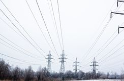 Electricity pylons and power lines in the winter day Royalty Free Stock Photography