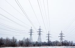 Electricity pylons and power lines in the winter day Royalty Free Stock Image