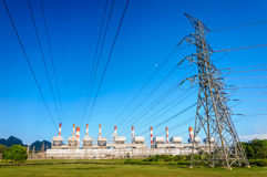 Electricity pylons and power plant Royalty Free Stock Image