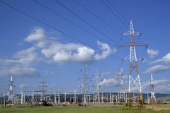 Electricity pylons and power s. Tation with blue sky Stock Photos