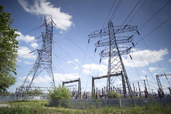 Electricity pylons. And a power station in england Royalty Free Stock Photo