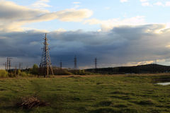 Electricity pylons. Electricity pylon on a background of clouds at sunset Royalty Free Stock Images