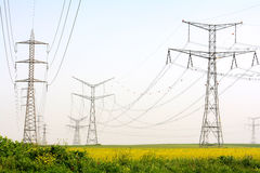 Electricity pylons. Rows of electricity pylons in the field stock photos