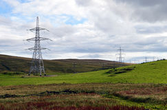Electricity pylons in Scottish beauty spot Stock Images