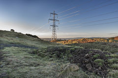 Electricity pylons in Scottish Field Royalty Free Stock Photography