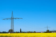 Electricity Pylons. Pylons standing out against countryside Royalty Free Stock Image