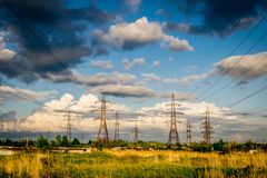 Electricity pylons with storm clouds royalty free stock photo