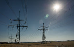 Electricity Pylons and sun Royalty Free Stock Image