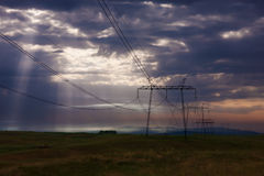 Electricity pylons at sunrise. Stock Photo