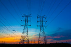 Electricity pylons at sunset Royalty Free Stock Photo