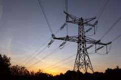 Electricity pylons at sunset Royalty Free Stock Photos