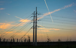 Electricity pylons during sunset Royalty Free Stock Photography