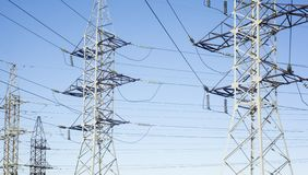 Electricity pylons. System of the electricity pylons against the blue sky royalty free stock images