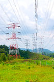 Electricity pylons or transmission towers Stock Photography