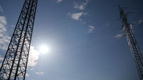 Electricity Pylons. Two electricity pylons in the country during sunny day. Full HD resolution. 200MB/s stock video
