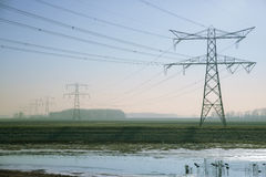 Electricity pylons in winter Royalty Free Stock Image