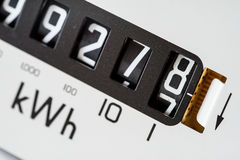 Electricity reading numbers close-up. Electricity meter close-up and showing kilowatt hour and reading digits royalty free stock photos