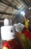 Electricity saving campaign. Activist replace old lamp to low energy lamp in order to campigning electricity saving in solo, central java, indonesia Royalty Free Stock Photos