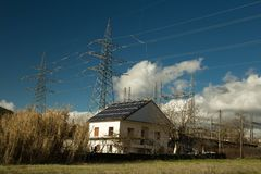 Electricity solar panels photovoltaic energy. House roof pylons Stock Photos