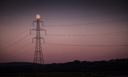 Electricity Stanchion and moon Stock Photo